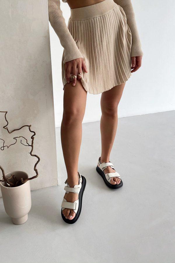 Трикотажная юбка мини плиссе кремовая